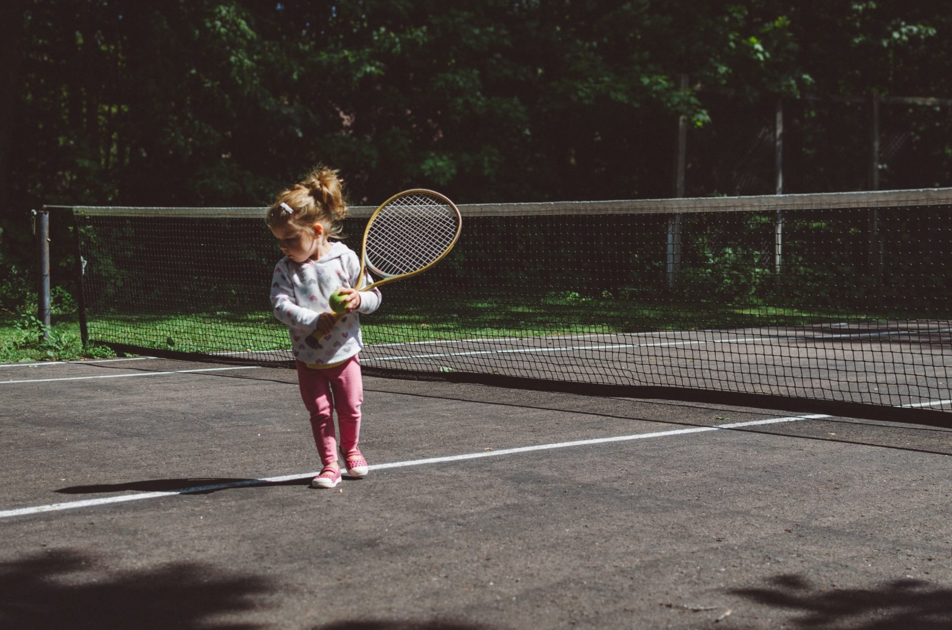 photo of child on tennis court by Kelly Sikkema on